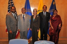 Photo of Kathleen Sebelius, Ghulam Nabi Azad, Dr. Griffin Rodgers, Dr. V.M. Katoch, and Krishna Tirath sign joint statement at the Hubert H. Humphrey Bldg. in Washington, D.C.