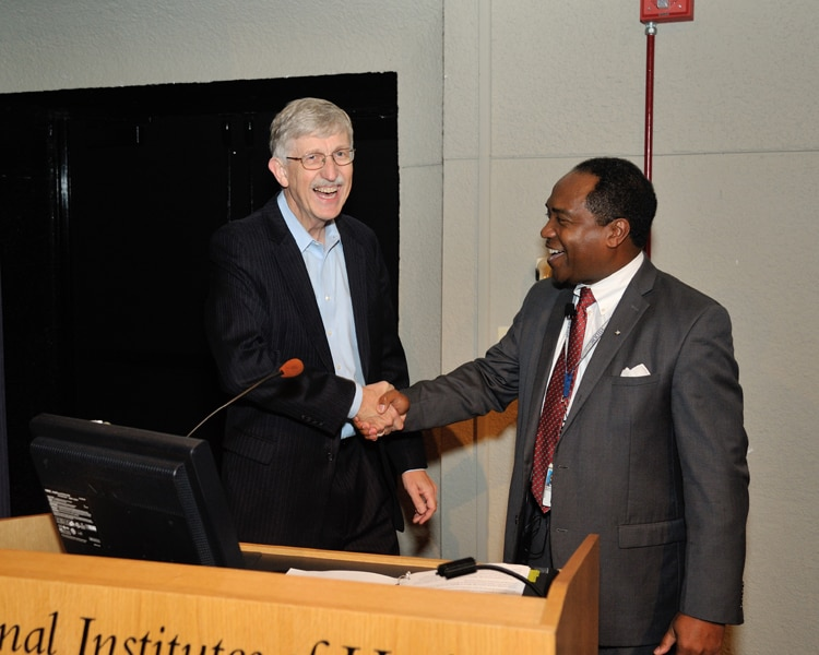 NIH Director Dr. Francis Collins shaking hands with NIDDK Director Dr. Griffin P. Rodgers
