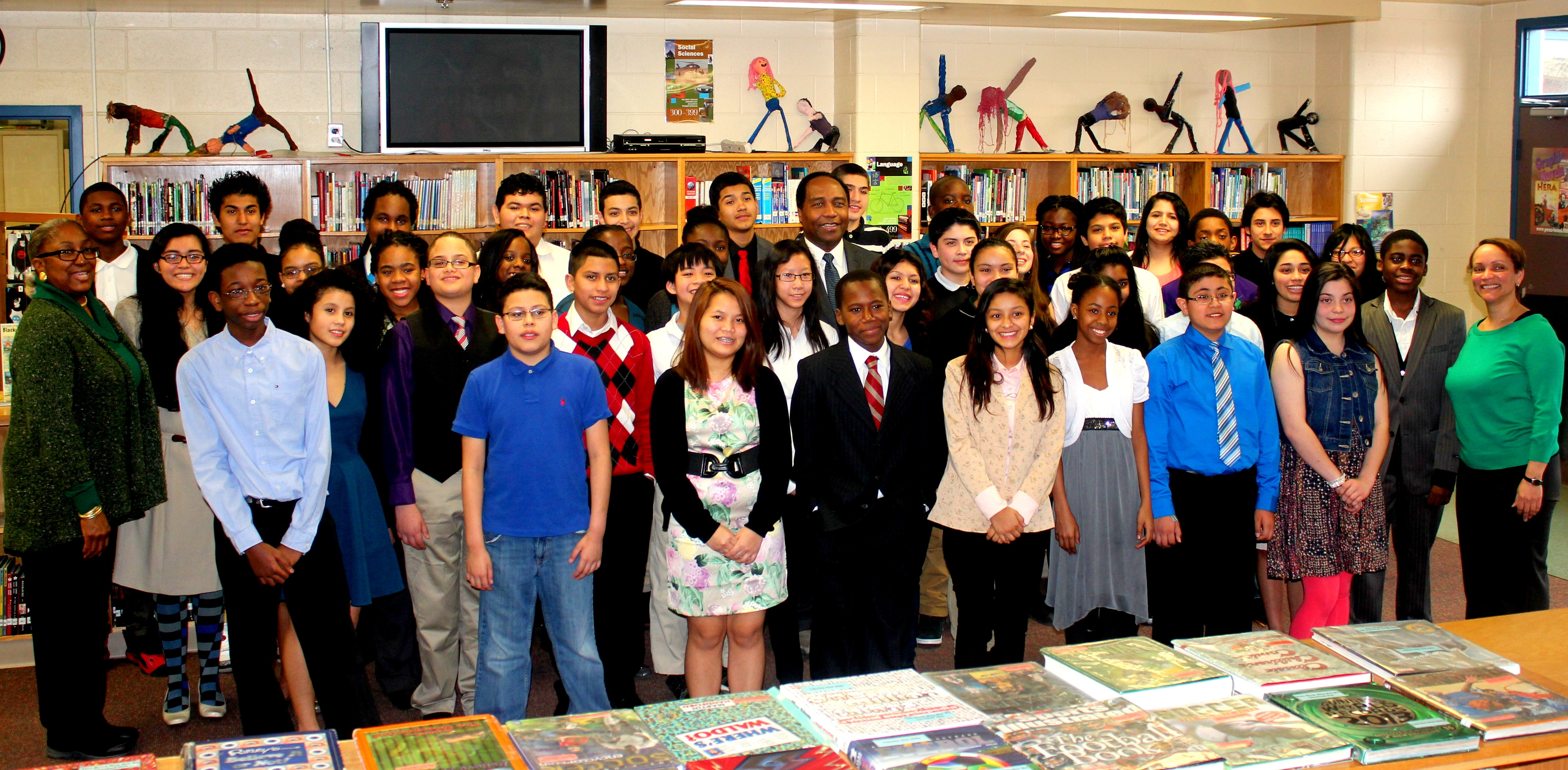 Photo of Dr. Griffin P. Rodgers with middle school students at Buck Lodge Middle School