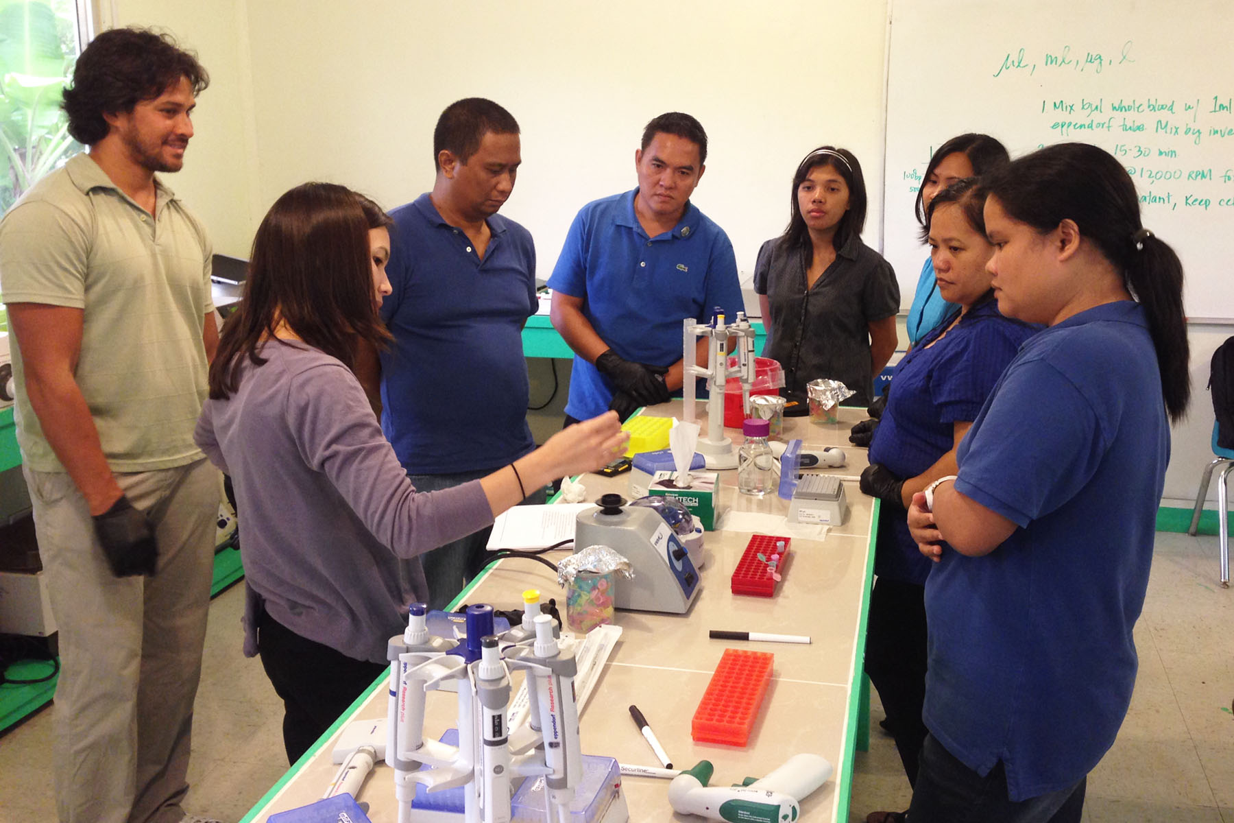 Photo of teachers helping STEP-UP students at the Pacific molecular biology laboratory in Palau.