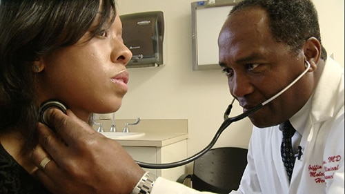 Photo of Dr. Rodgers examining a patient
