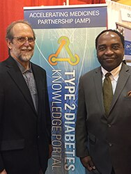 Photo of NIDDK Deputy Division Director Dr. Phillip Smith and NIDDK Director Dr. Griffin P. Rodgers