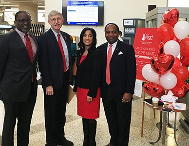 Photo of Dr. Griffen P. Rodgers and fellow NIH leaders wearing red to commemorate National Wear Red Day, part of American Heart Month