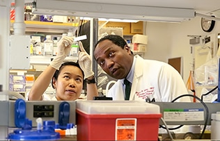 Dr. Rodgers plus lab member from b-roll developed for Sammies nomination