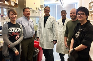 Dr. Jason Mills from Washington University with team