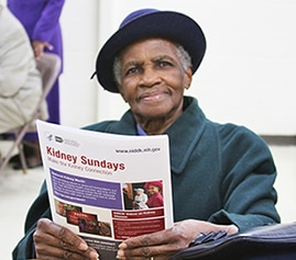 Photo of Willie M. Allen holding NIDDK Kidney Sundays educational materials