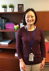 Photo of Dr. Jessica Lee standing at desk