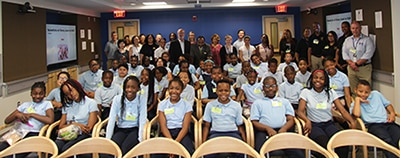 Group photo of Dr. Griffin P. Rodgers with staff and students from Kettering Elementary School in Prince George's County that visited NIH's campus on May 21 for a tour.