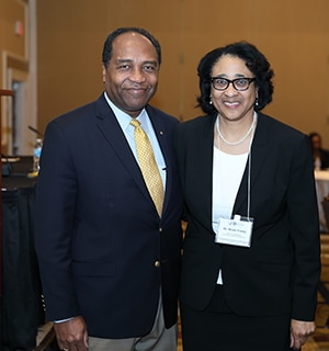 photo of Dr. Griffin P. Rodgers with Dr. Bessie Young at the 16th annual NMRI workshop.