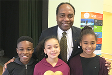 Photo of Dr. Griffin P. Rodgers with students from William B. Gibbs Elementary School in Germantown, Maryland.
