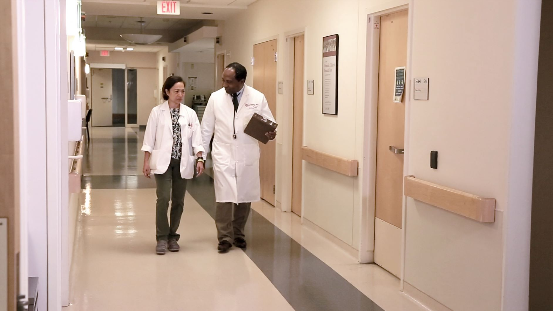 Dr. Rodgers walking through a hallway talking with another doctor.