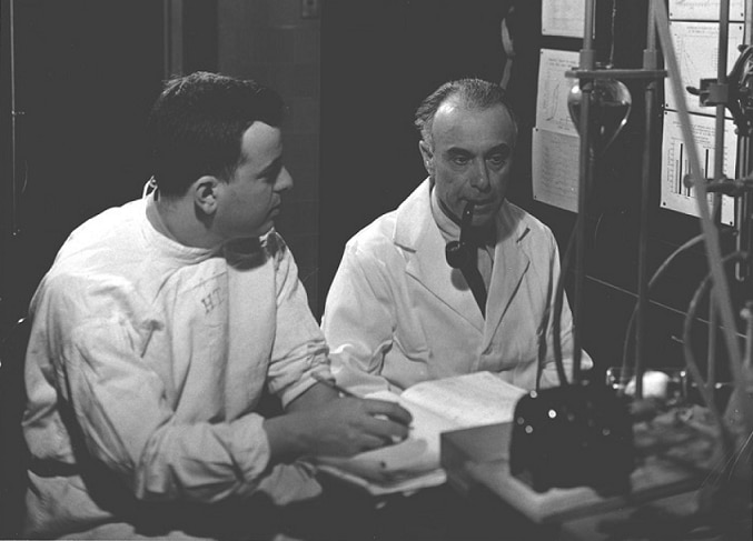 Herbert Tabor and Sanford Rosenthal in a lab in 1944