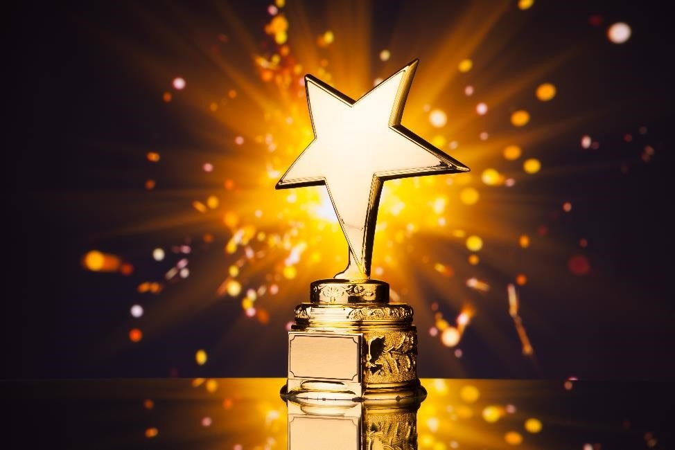 Gold star trophy with sparks flying behind it.