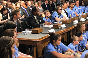 Photo of speakers discussing the burden of type 1 diabetes and the effect of research progress during a hearing held by the Senate Special Committee on Aging