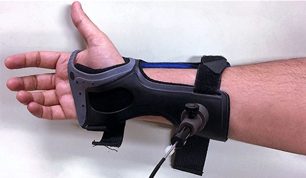 A brace on a mans arm