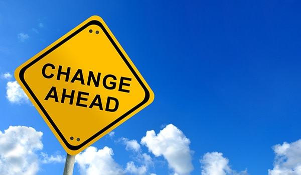 Change Ahead yield sign with blue sky background