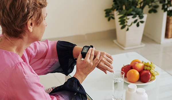 A woman checking her smart watch.