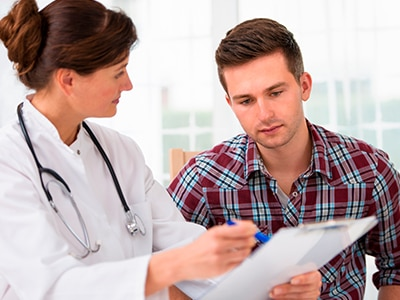 Doctor reviewing information with a patient