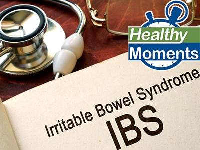 "A stethoscope and a notebook with the words, ""Irritable Bowel Syndrome"" and ""IBS"""