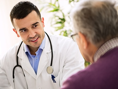 Man speaking with a health care professional