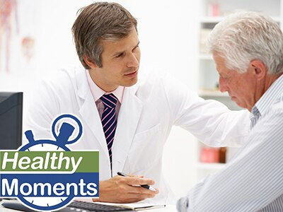 Doctor speaking with an older man
