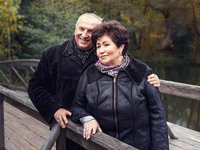 Male and female couple standing together on a bridge
