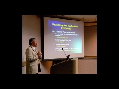A man presenting at an NIH seminar