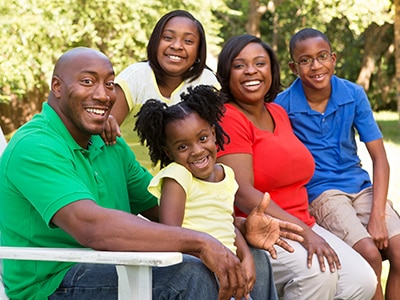 African American family sitting together outside