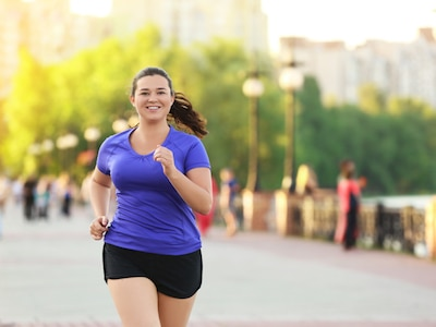 Woman jogging in a park.