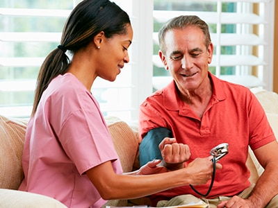 Health care professional checking a patient's blood pressure