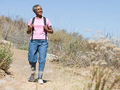 Woman with a backpack hiking outdoors