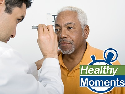 Eye doctor examining a man's eyes