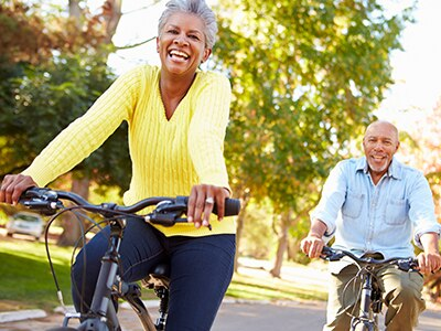 Man and woman riding bicycles outdoors