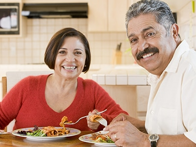 Hispanic couple eating a healthy dinner