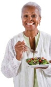 Old woman eating salad