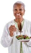 Old woman eating salad