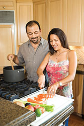 Man and woman cooking a meal together