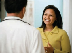A woman speaks with her doctor