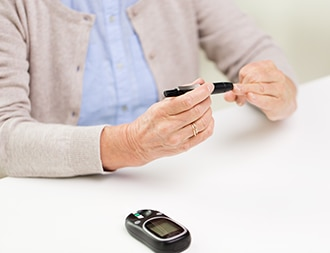 Woman checking blood glucose.