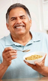 Man eating bowl of cereal
