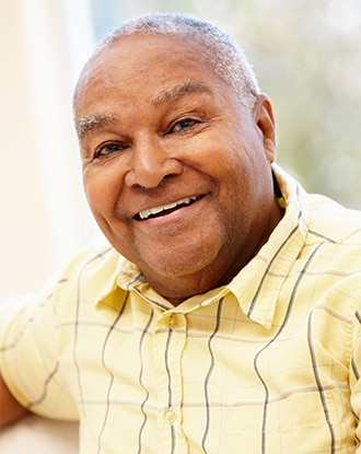 A smiling overweight older man