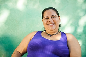 An overweight Hispanic woman smiling