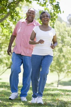 Smiling couple walking in a park.