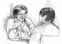Image of a female doctor talking with an Asian female patient. They are sitting across from each other at a table.