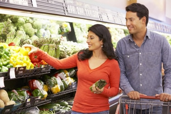 Man and woman shopping for produce.