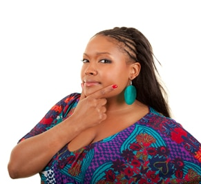 Woman with her hand on her chin thinking about making changes in her habits.