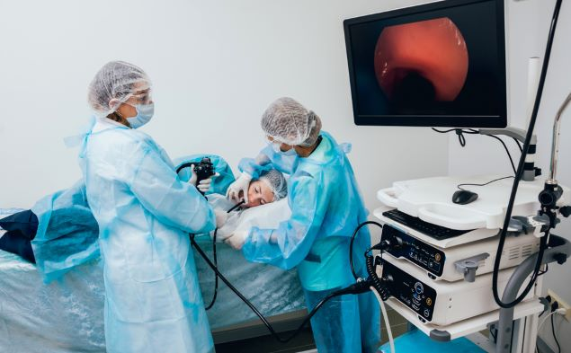 Health care professionals performing an upper GI endoscopy.