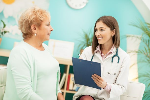 Doctor talking with an older female patient.