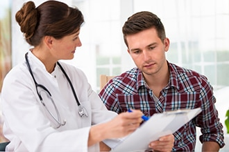 Doctor reviewing information with a patient.