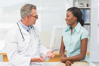 Doctor talking with a patient.